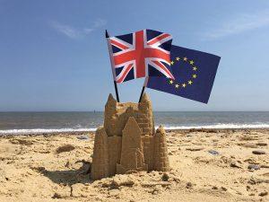 united kingdom and European Union flags on the beach